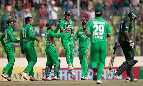 Bangladesh fielders celebrate at the Asia Cup in Dhaka