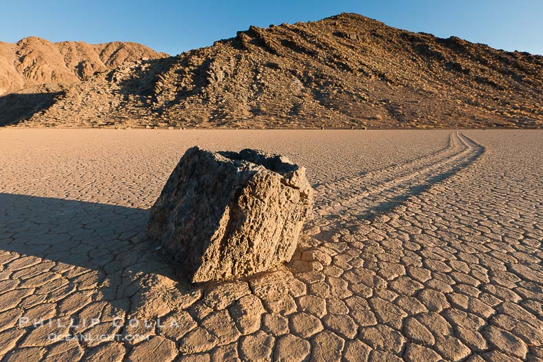 Sailing stone on the Racetrack Playa. The sliding rocks, or sailing stones, move across the mud flats of the Racetrack Playa, leaving trails behind in the mud. The explanation for their movement is not known with certainty, but many believe wind pushes the rocks over wet and perhaps icy mud in winter