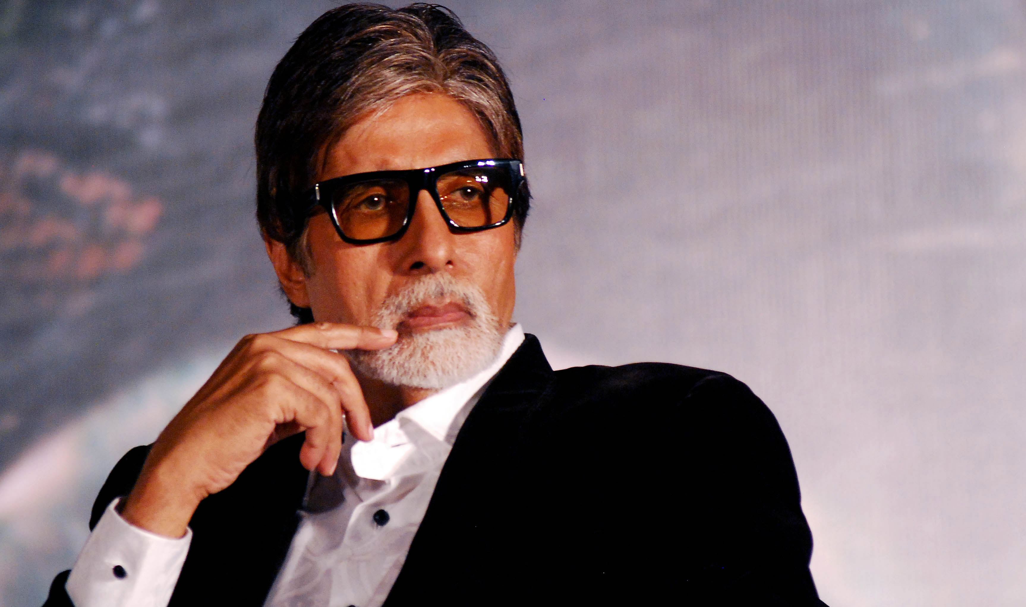 """Indian Bollywood actor Amitabh Bachchan attends a promotional event for the updated """"Raghupati Raghava Raja Ram"""" and the upcoming political thriller Hindi film """"Styagraha"""" in Mumbai on July 25, 2013. AFP PHOTO/STR"""