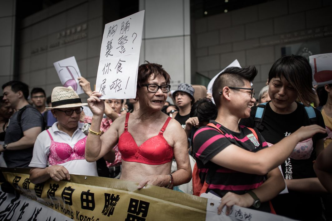 Protesters wear bras during a demonstration outside the police headquarters in Hong Kong on August 2, 2015. The demonstrators gathered in support of a Hong Kong woman who was sentenced to three-and-a-half months jail for using her breast to bump a police officer during a protest.  AFP PHOTO / Philippe LopezPHILIPPE LOPEZ/AFP/Getty Images