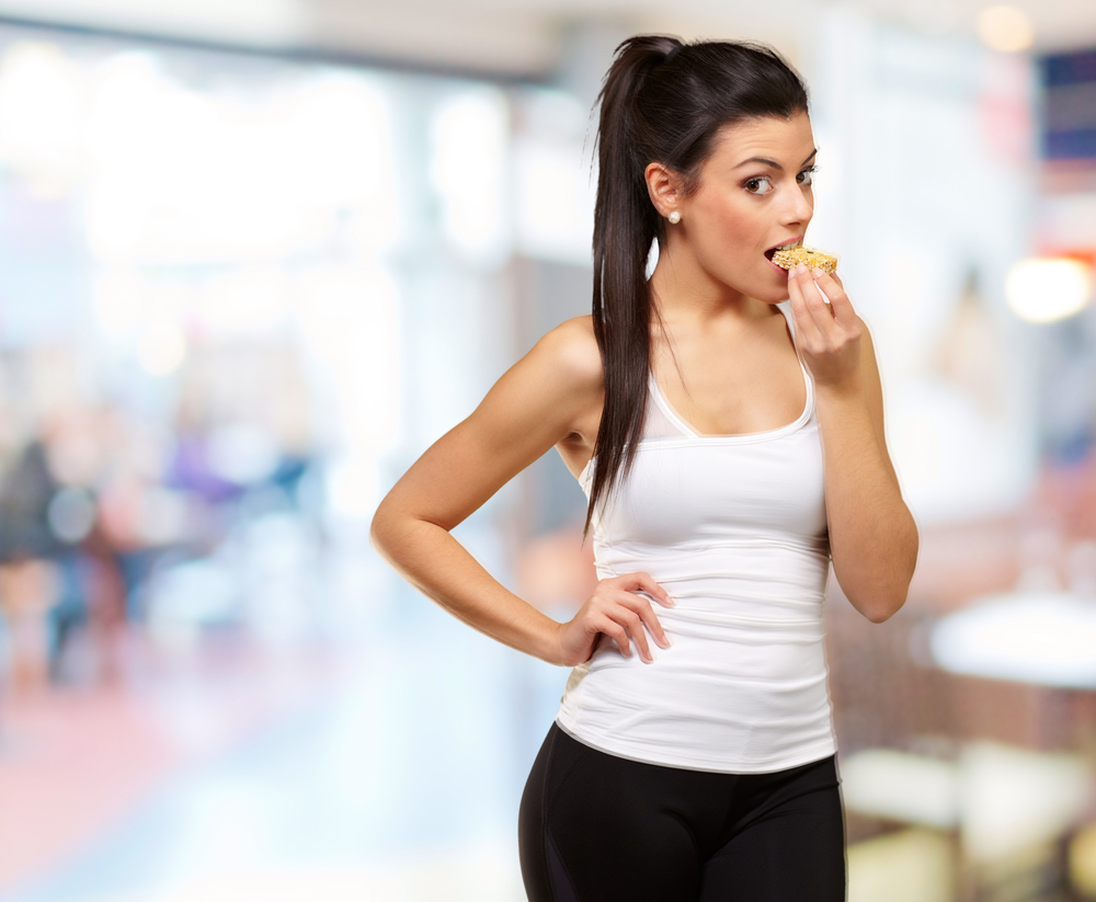 young-woman-eating-and-working-out
