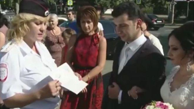 150906085244_russia_wedding_police_640x360_bbc_nocredit