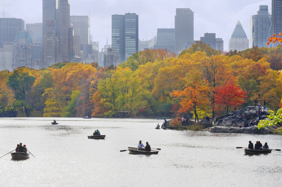 People in boats on lake in Central Park