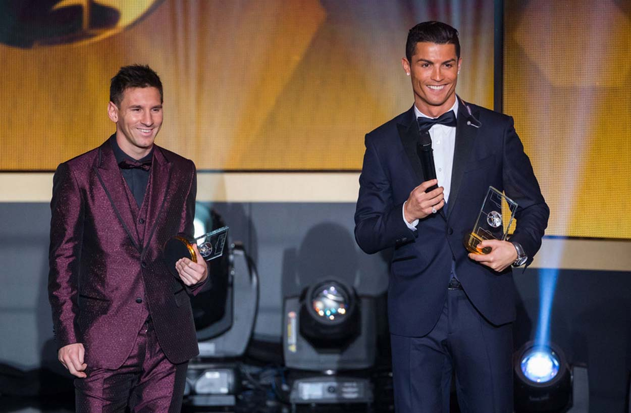 Messi-and-Ronaldo-smiling-to-the-crowd-and-looking-like-good-friends.jpg.pagespeed.ce_.wuHvIq7R7B