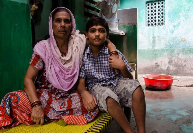 ***EXCLUSIVE***  WEST BENGAL, INDIA - UNDATED: Sultana Begum is seen with her Grandson Muhammed Jejan (her daughter Tanveer's son) in West Bengal, India.  A DESCENDANT of India's last Mughal emperor is living in a poverty-stricken slum. Illiterate Sultana Begum, the great grand daughter-in-law of the last Mughal emperor Bahadur Shah Zafar, is living in a tiny two room home in the Howrah slum. Ever since the death of her husband, Prince Mirza Bedar Bukht, Sultana has struggled to make ends meet - first running a tea stall and now selling traditional female garments such as Salwar suits. But life wasn't always like this for the Princess, her relatives once ruled over the country with all the trappings that came with royalty.  PHOTOGRAPH BY Sujanya Das / Barcroft India  UK Office, London. T +44 845 370 2233 W www.barcroftmedia.com  USA Office, New York City. T +1 212 796 2458 W www.barcroftusa.com  Indian Office, Delhi. T +91 11 4053 2429 W www.barcroftindia.com