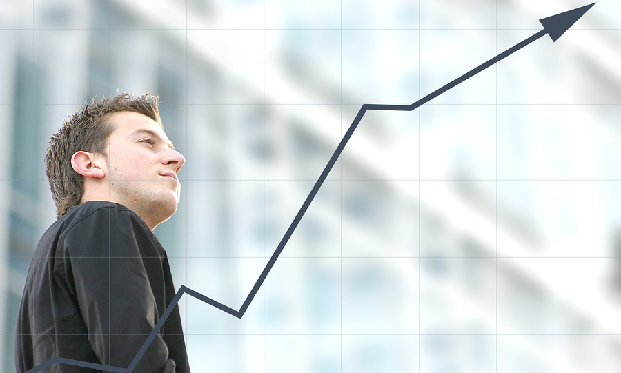 confident business man with a graph goind upwards