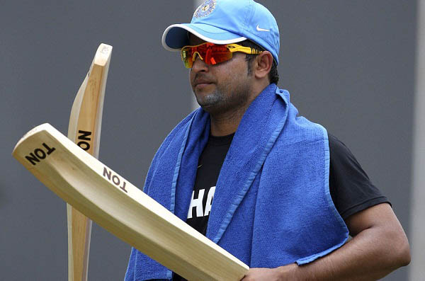 Indian cricketer Suresh Raina checks his bats during a training session ahead of their second Twenty20 cricket match against New Zealand in Chennai, India, Monday, Sept. 10, 2012. The first Twenty20 game between India and New Zealand was washed out without a ball being bowled in Visakhapatman on Saturday. (AP Photo)