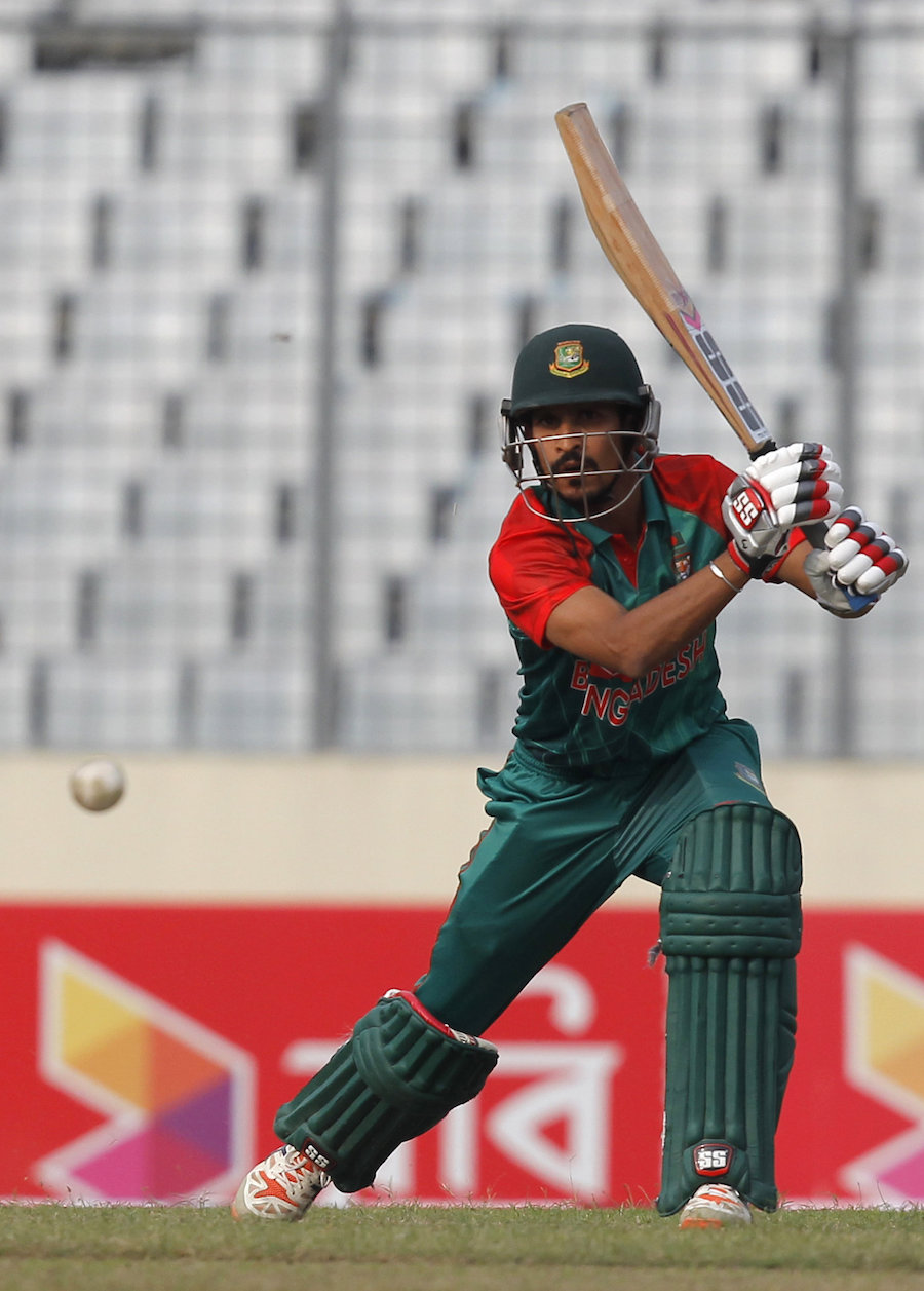 Bangladesh's Nasir Hossain plays a shot  during the second one day international cricket match against Zimbabwe, in Dhaka, Bangladesh, Monday, Nov. 9, 2015. (AP Photo/A.M. Ahad)