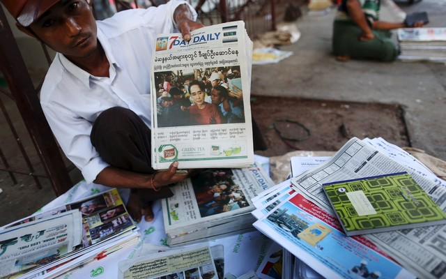 A+news+vendor+displays+local+newspapers+on+a+street+in+Yangon