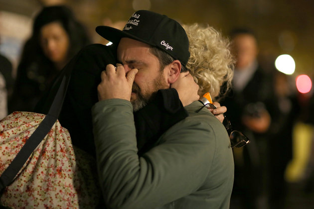PARIS, FRANCE - NOVEMBER 14:  A couple cries in each other's arms at a spontaneous gathering of Parisians at Place de la Republique on November 14, 2015 in Paris, France. At least 120 people have been killed and over 200 injured, 80 of which seriously, following a series of terrorist attacks in the French capital.  (Photo by Pierre Suu/Getty Images)