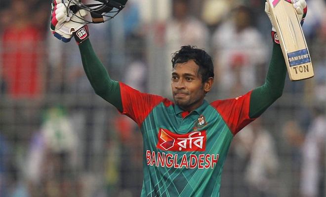 Bangladesh's Mushfiqur Rahim acknowledges the crowd after scoring a century during their first one day international cricket match against Zimbabwe in Dhaka, Bangladesh, Saturday, Nov. 7, 2015. (AP Photo/A.M. Ahad)