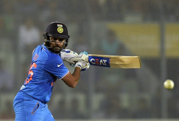 Indian cricketer Rohit Sharma plays a shot during a Twenty20 cricket match between India and Bangladesh for the Asia Cup T20 cricket tournament at The Sher-e-Bangla National Cricket Stadium in Dhaka on February 24, 2016. AFP PHOTO/Munir uz ZAMAN / AFP / MUNIR UZ ZAMAN        (Photo credit should read MUNIR UZ ZAMAN/AFP/Getty Images)