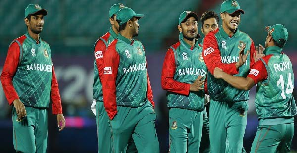 Bangladesh'players celebrate after they defeated Oman in the ICC World Twenty20 2016 cricket tournament at the Himachal Pradesh Cricket Association (HPCA) stadium in Dharamsala, India, Sunday, March 13, 2016. (AP Photo /Tsering Topgyal)