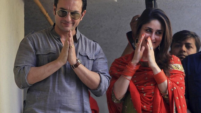 Bollywood stars Saif Ali Khan, left, and Kareena Kapoor greet waiting fans after getting married in Mumbai, India, Tuesday, Oct. 16, 2012. The Press Trust of India reported the couple married Tuesday in a small official ceremony in Khan's house in Mumbai with a few friends and family members in attendance. (AP Photo)