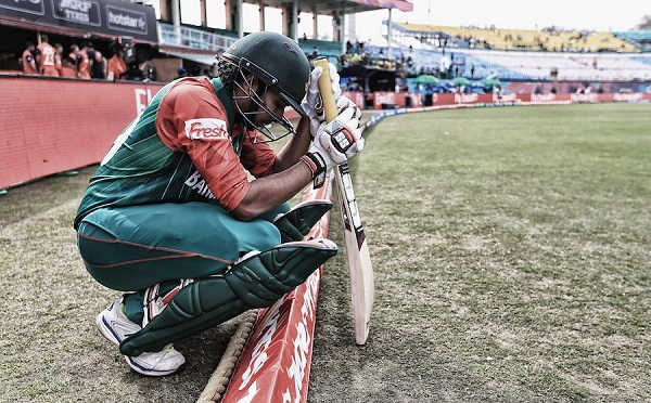 DHARAMSALA, INDIA - MARCH 09:  (Editors note: This image has had a digital filter applied to it) Soumya Sarker of Bangladesh says a prayer before going out to bat the ICC Twenty20 World Cup match between Bangladesh and Netherlands at HPCA Stadium on March 9, 2016 in Dharamsala, India.  (Photo by Matthew Lewis-IDI/IDI via Getty Images)