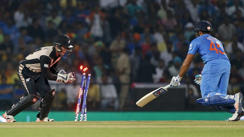 India's Rohit Sharma is stumped by New Zealand's Luke Ronchi during the ICC World Twenty20 2016 cricket match at the Vidarbha Cricket Association stadium in Nagpur, India, Tuesday, March 15, 2016. (AP Photo/Saurabh Das)