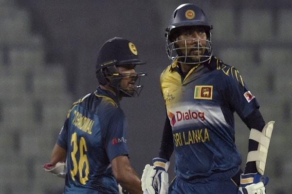 Sri Lanka cricketers Tillakaratne Dilshan (R) and Dinesh Chandimal run between the wickets during the Asia Cup T20 cricket tournament match between Pakistan and Sri Lanka at the Sher-e-Bangla National Cricket Stadium in Dhaka on March 4, 2016. / AFP / MUNIR UZ ZAMAN        (Photo credit should read MUNIR UZ ZAMAN/AFP/Getty Images)