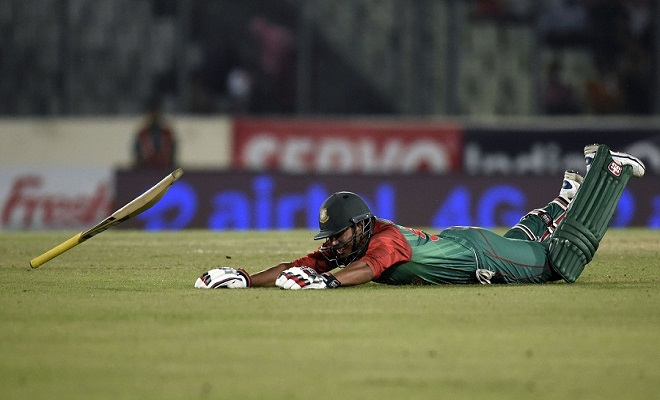 Bangladesh cricketer Soumya Sarkar jumps during a run at the Asia Cup T20 cricket tournament final match between Bangladesh and India at the Sher-e-Bangla National Cricket Stadium in Dhaka on March 6, 2016. / AFP / MUNIR UZ ZAMAN        (Photo credit should read MUNIR UZ ZAMAN/AFP/Getty Images)