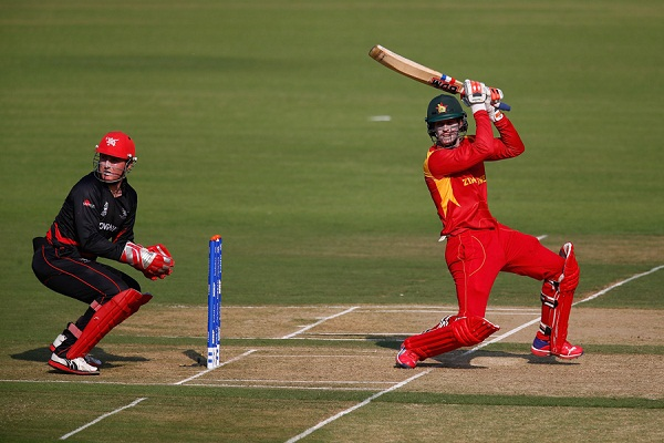 NAGPUR, INDIA - MARCH 08:  Malcolm Waller of Zimbabwe in action with wicket keeper James Atkinson of Hong Kong during the ICC Twenty20 World Cup Group B match between Zimbabwe and Hong Kong at the Vidarbha Cricket Association Stadium on March 8, 2016 in Nagpur, India.  (Photo by Christopher Lee-IDI/IDI via Getty Images)