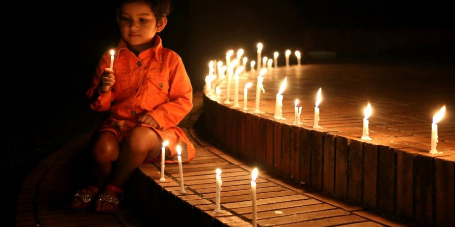 BAU a small child lighted candle for tanu 1