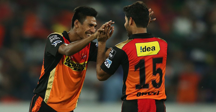 Mustafizur Rahman of Sunrisers Hyderabad and Bhuvneshwar Kumar of Sunrisers Hyderabad celebrate getting Ravindra Jadeja of Gujarat Lions wicket during match 34 of the Vivo IPL 2016 (Indian Premier League) between the Sunrisers Hyderabad and the Gujarat Lions held at the Rajiv Gandhi Intl. Cricket Stadium, Hyderabad on the 6th May 2016  Photo by Shaun Roy / IPL/ SPORTZPICS