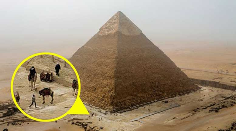 PAY-Man-illegally-climbs-pyramid-in-Cairo