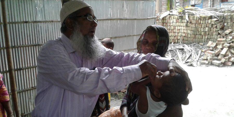 UH&FPO dr. Md. Sirajul Islam Providing Vitamin A capsul