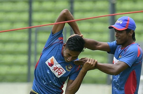 Bangladesh cricketer Rubel Hossain (R) shares a light moment with teammate Mustafizur Rahman during a practice session at The Sher-e-Bangla National Cricket Stadium in Dhaka on July 1, 2015, ahead of a series of matches against South Africa, Bangladesh will face South Africa in two Twenty20 internationals, three ODIs and two Tests starting July 5. AFP PHOTO/ Munir uz ZAMAN        (Photo credit should read MUNIR UZ ZAMAN/AFP/Getty Images)