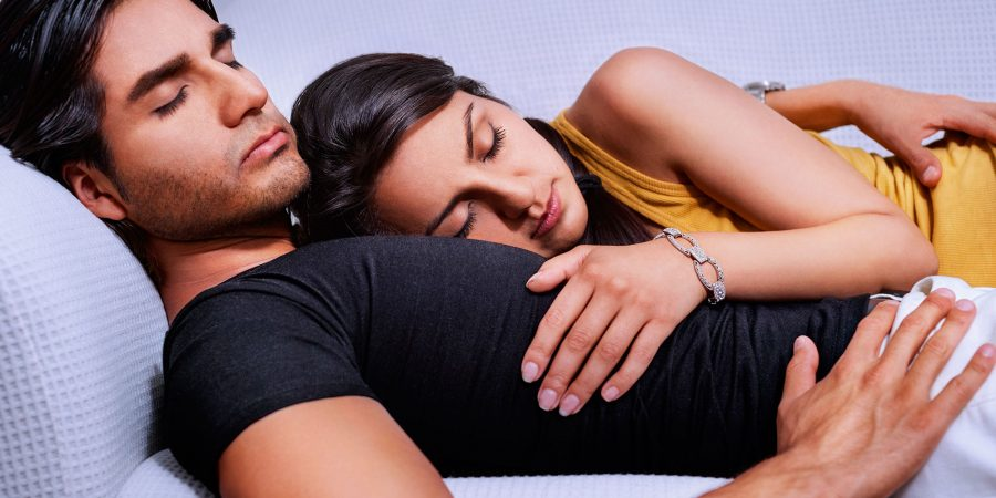 man_and_woman_sleeping_on_a_couch