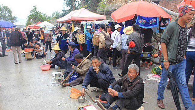 """Pic shows: Jobless and homeless come together to beg from templegoers.  It's not exactly the Beggar's Banquet but every year thousands of homeless and unemployed come together to take advantage of well-wishers offering gifts, food and money in an age old tradition.  As part of a celebration to mark the birthday of Ksitigarbha Buddha, otherwise known as Yama, the Chinese King of Hell, tens of thousands of locals flock to a temple in the town of Dali, in south-west China's Yunnan Province, to bring offerings to the spirits of the dead.  For believers the day, which falls on the 28th day of the third month of the Chinese lunar calendar, sees Yama open the gates of Hell so that the living can worship the dead.  The worshippers bring rice, chicken, fruit, wine and tea to the temple which they believe will please the spirits.  But they also give generously to the beggars, believing that it will bring them luck and good karma for doing a good deed.  Local woman Lien Ni, 54, said: """"The occasion is very important for us and we celebrate it with firecrackers and songs.  """"Over the years the beggars have started gathering here too as they can get lots of freebies which they wouldn't ordinarily get.  """"We call it the Beggars' Conference as they not only take from us but also swap items with each other.""""  The annual get together, which fell on May 16 this year, also coincides with a centuries old tradition where beggars used to meet up to take part in marital arts competitions.  In ancient Chinese novels, gangs of roaming beggars known as Beggar Gangsters, congregated on Dali to take part in the fights.  Homeless man Yi Liao, 45, said: """"It's a nice story but today we don't do martial arts.  """"We meet, chat, and get well fed by the kindly temple visitors.  """"They are happy, we are happy and the spirits of the dead are happy.""""  (ends)"""
