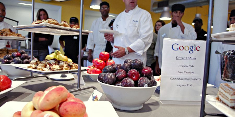 Chef Gary Gibson surveys the day's desserts with staff in the cafeteria of the Google office at 111 8th Avenue, Monday, October 2, 2006 in New York.  Photographer:  Daniel Acker/Bloomberg News.